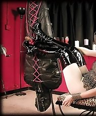 Slave tied in leather bag