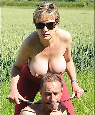 Busty mature dominatrix outdoors